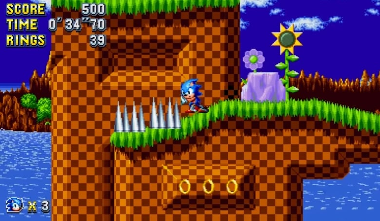 Sonic the Hedgehog pushing against spikes.