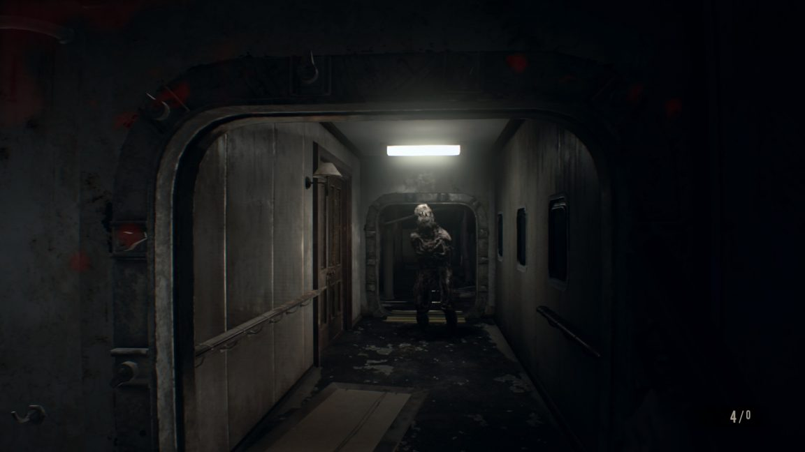 Resident Evil 7 showing a monster coming down a corridor