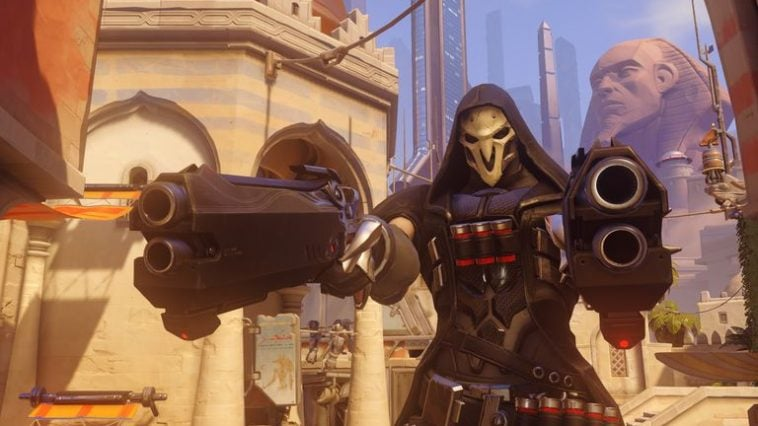 An Overwatch character pointing two guns