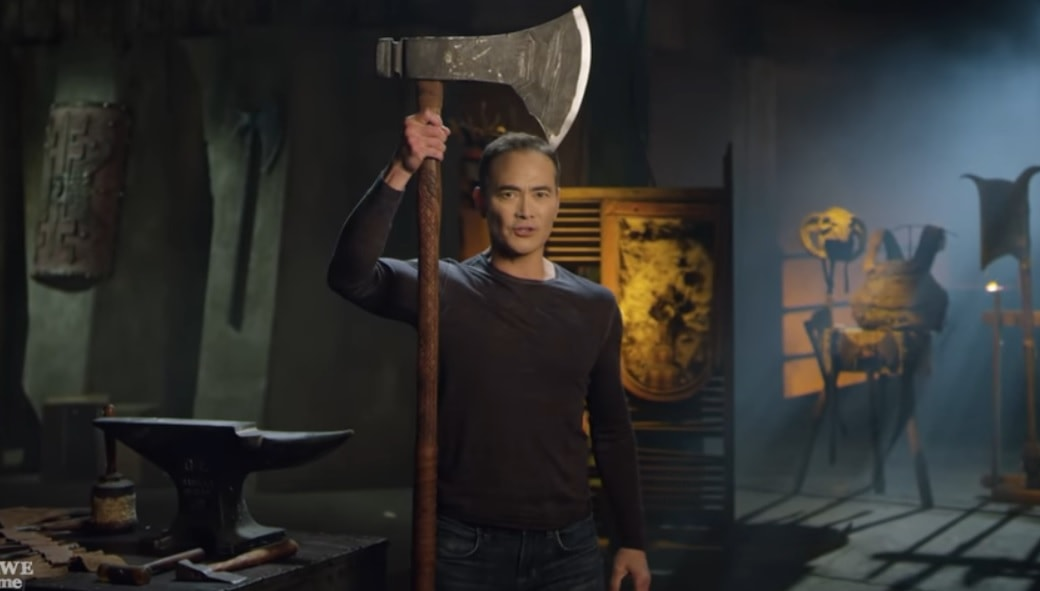 A man with a large For Honor axe