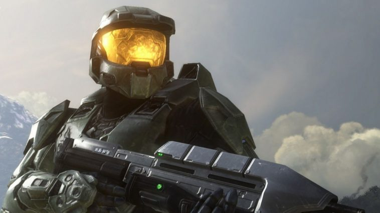 Master Chief in Halo with a gun and his golden visor gleaming.