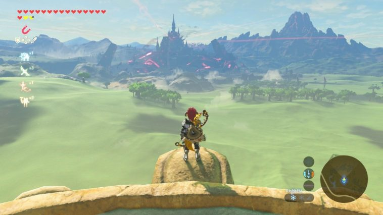 Legend of Zelda Breath of the Wild, Link looking down from a vantage point onto green fields, a forest and a castle in the distance.