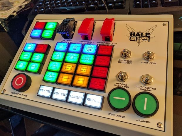 A custommade DIY Elite Dangerous controller, made from wood with glowing buttons.