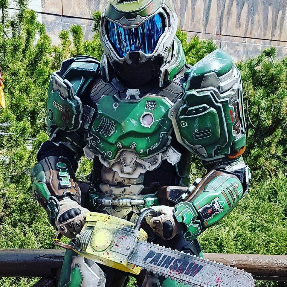 Doom Guy cosplay, showing the main character in green clutching a chainsaw.