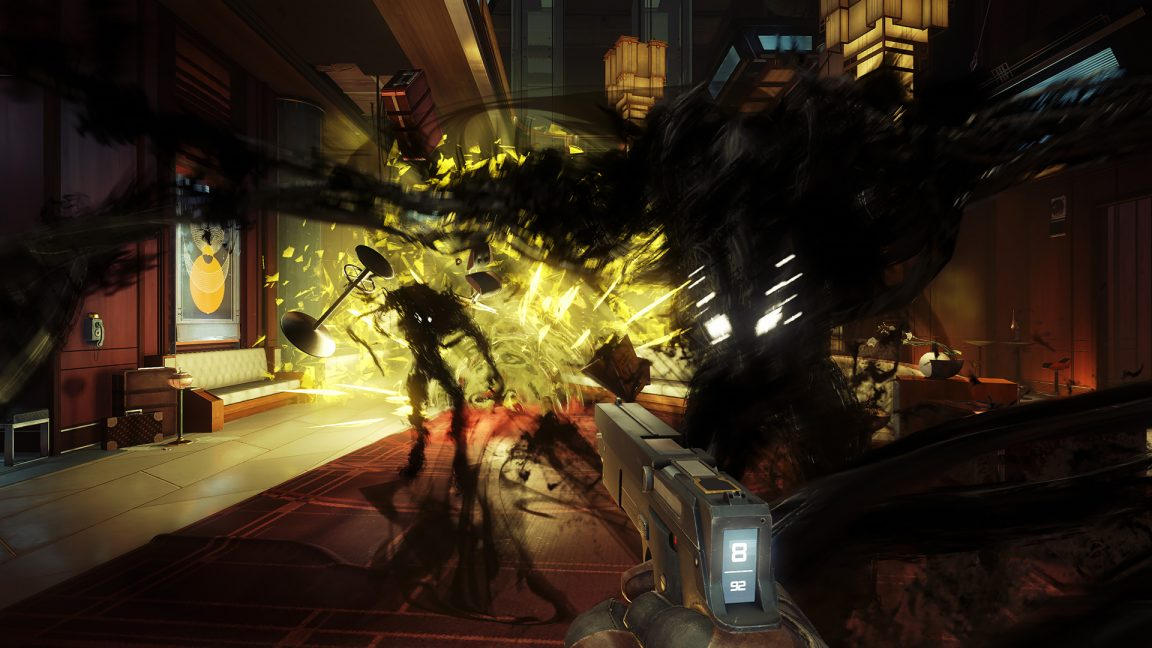 A scene from Prey showing 2 enemies attacking while a fire burns.