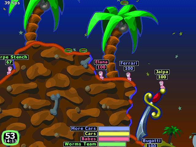 Worms video game showing the worms characters on a brown level.