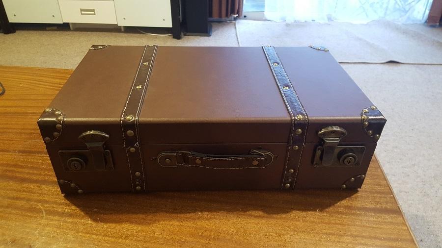 A brown briefcase housing an arcade.