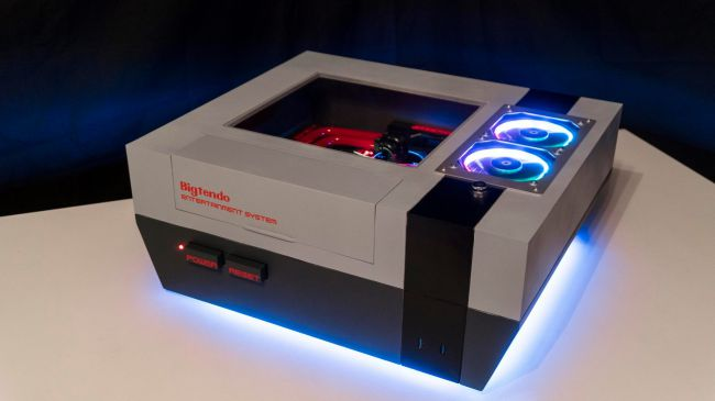 A large NES Nintendo Entertainment console with a gaming PC built inside that glows.