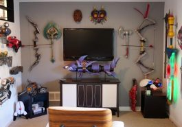 A room filled with video game memorabilia with a large TV.