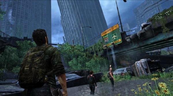 Last of Us showing Joel looking up at ruined buildings.