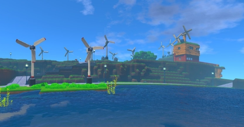 Lots of wind turbines on a grass verge and blocky mountain.
