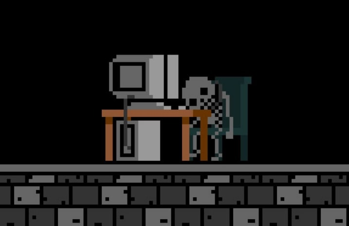 A pixelated skeleton sitting at a computer desk.