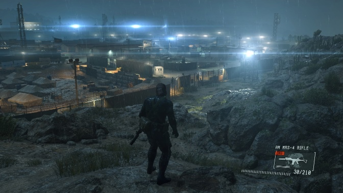 Big Boss looking over a camp in the distance from on top of a mountain.