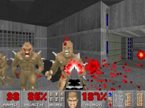 Doom 2 shooting enemies with a shotgun as blood flies everywhere.