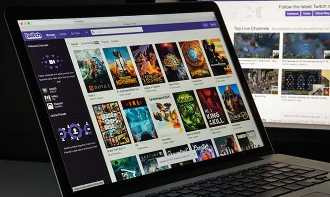 An open laptop with Twitch on the screen, displaying a selection of video games.