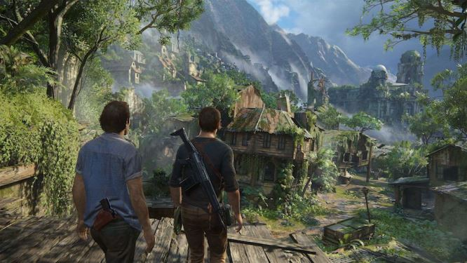 Nathan Drake and a friend overlooking a village and forest.